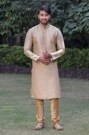 Elegant Beige colored textured Kurta Set