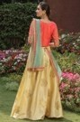 Exclusive Golden Lehenga with Orange Blouse and Contrasting Dupatta